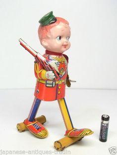 Fukuda Boy with gun Tin Toy from 30s  ebay
