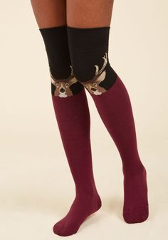 Want to try out some over-the-knee socks? Get your collection started with this black pair! Touting a stoic brown stag peeking over each burgundy colorblock, these thigh-highs will quickly become the 'deerest' pair in your sock drawer!