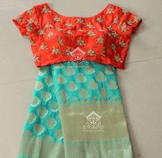 Cyan blue Banarasi Silk Saree from Varuni Gopen Collections. Saree is paired with short sleeves contrast orange raw silk blouse. Pattu Saree Blouse Designs, Saree Blouse Patterns, Kurta Designs, Dress Designs, Elegant Saree, Fancy Sarees, Indian Sarees, Silk Sarees, Banaras Sarees