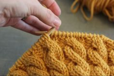she makes hats: A cable knitting trick.