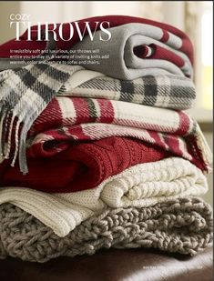 Dress your bed for Christmas with festive throws in red, white and grey.