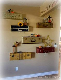 Old suitcases used as display shelves ... this is a gorgeous interpretation of a project featured in last fall's issue of Flea Market Style Magazine.  Click on the picture to see the step by step process used by Korrie at Red Hen Home to create this lovely wall in her own home ... lots and lots of photos, and be sure to scroll to the bottom to check out her stenciled stairway, too.