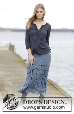 """Crochet DROPS skirt with lace pattern and trebles, worked in each direction from crochet squares in """"Fabel"""". Size S-XXXL."""
