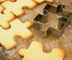 Puzzle Shaped Cookie Cutter It's never been a better time to play with your food than now. These cookie cutters let you form your cookies into puzzle pieces that actually connect together once they're baked. Although it may be a little tricky to finish the puzzle without eating any of the pieces.