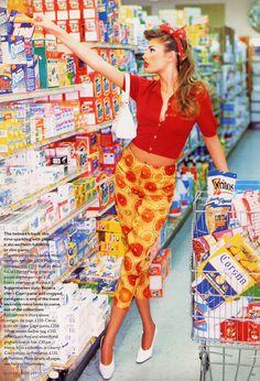 Bridget Hall making the tough decisions. Shot by Ellen Von Unwerth for Vogue UK June, 1995.