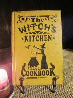 The Witch's Kitchen Cookbook, Primitive Halloween Decoration on Etsy, $21.99