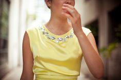 Swarovski crystal beaded neckline.  No need for a necklace...