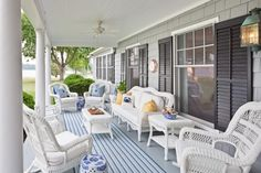 love white wicker and blue on a sun porch