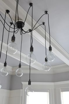 LOVE this chandelier, would make with Edison bulbs... kitchen island?
