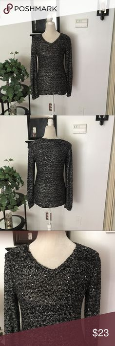 Apt. 9 Long Sleeve Black Silver Sweater Apt. 9 Long Sleeve Black Silver Sweater. In very good condition. Has a built in top underneath as seen in pic #2. Hi/low sweater. Shell: 42% polyester,34% acrylic, 23% nylon,1% other fiber. Lining: 100% polyester Apt. 9 Sweaters