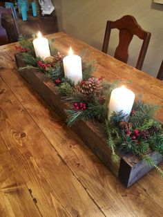 Elegant Christmas Table Centerpieces To Your Holiday Decor Charming wooden box centerpiece filler with greenery, candles and pinecones. More from my site Elegant Christmas Table Centerpieces To Your Holiday Decor Christmas Candle Decorations, Christmas Signs Wood, Christmas Diy, Christmas Staircase, Christmas 2019, Christmas Candles, Christmas Decorating Ideas, Merry Christmas, Christmas Centrepieces