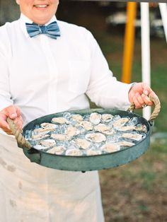 oysters on the half make for a delicious passed hors d'oeuvre as featured in Weddings Unveiled Magazine | calder clark© | @nancyray | @brookgreen1 | @wumag | #serverattire #bowtie #apron #rawbar #oysterbar