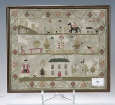 An early 19th century embroidered sampler Mary Orchard, 1835,