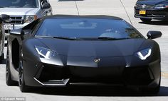 Nice ride: Kim Kardashian and Kanye West, of course, rolled up in style, driving through the gates of the exclusive enclave in the Aventador