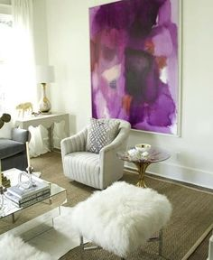 A beautiful purple painting can really brighten up the neutral look of a beige and white room.