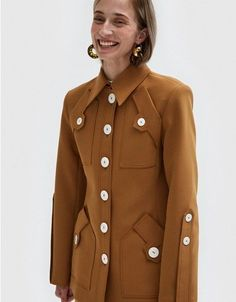 NOTE: UK SIZES LISTED. See sizing guide for conversion information. Safari-style jacket from Ellery in Camel. Pointed collar. Padded shoulders. Long sleeves with elongated tab detail. Front button closure. Four patch pockets. Contoured seams at front.
