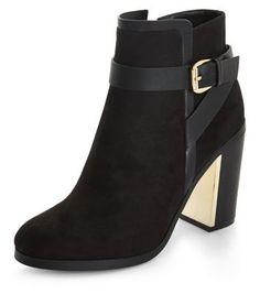 - Buckle strap detail- Soft finish- Block heel- Zip side fastening