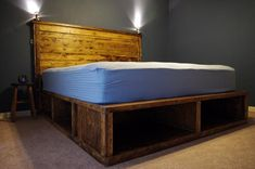 I have found some great and easy to make DIY platform beds that you can make it on your own. The material would be wood and the rest depends on your