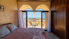 The main bedroom is located upstairs, with its own ensuite and a wraparound terrace that provides views on three sides. Concrete Cover, Rammed Earth Wall, Arch Doorway, Best Architects, Storey Homes, Thatched Roof, Mexico Vacation, Ground Floor Plan, Open Concept Kitchen