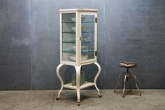 vintage pharmacy apothecary cabinet.