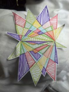 Simple art lesson involving maths - draw a 10cm line in middle of page. Scatter five dots above and five below the line. Join each dot to both ends of the centre line (can label for those who need support!) Colour in & decorate the starburst, no two colours can touch!