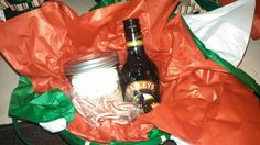 Hot chocolate mix with marshmallows in a mason jar with a small bottle of Baileys or Kaluha, and candy canes and Baileys chocolates.  Inexpensive gifts for co-workers.