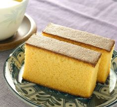 Yuzu mousse cake, with a green tea sponge base. Topped