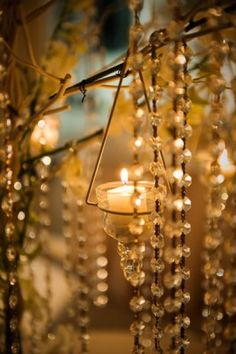 Candles and pearls.  (I think this is crystals)  I like this idea for an outdoor evening tea party....   a chandelier look.