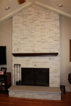 Brick Fireplace Makeover done with a stone plaster and glaze