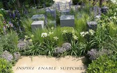 a positive message of 'Inspire. Enable. Support' appears in the Help the Heroes garden....Chelsea Flower Show 2014