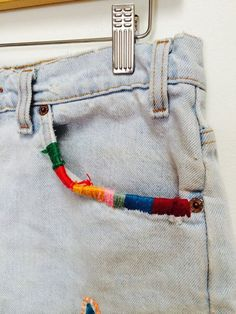 Embroidered pockets. Gloucestershire Resource Centre http://www.grcltd.org/scrapstore/