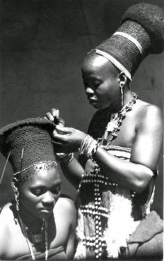Young Zulu woman having her hair or headdress done - South Africa 20th century