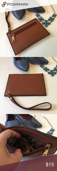 New Faux Brown Wristlet Small faux leather wristlet with small zipper. Bags Clutches & Wristlets