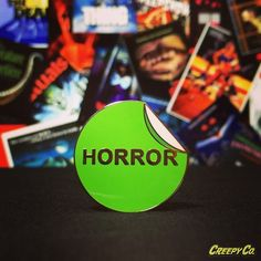 """Our VHS Horror Label Enamel Pin! Horror fan? Child of the 80s (or thereabouts)? Then you get it. 1"""", shiny hard enamel, freaking gorgeous yet understated pin. www.creepycompany.com 💀👻👽🔪🎬🎥📼 #horror #horrormovies #vhs #vhshorror #vhshorrorsticker #nostalgia #enamelpin #enamelpins #lapelpin #lapelpins #horrorpins #horrorart #wearableart #pinsofig #pinstagram #creepyco #creepycompany"""
