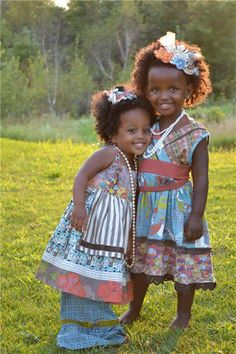 Gorgeous little curly girls playing dress-up