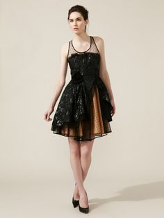 Woven Brocade Mesh Tea Dress by RED Valentino.  Not really my normal style, but it sure looks like a fun dress!