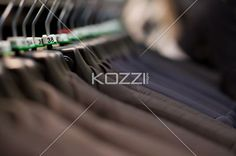 suits displayed in clothes store. - Close-up of suits displayed in clothes store.