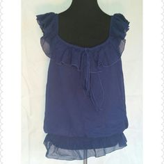 Navy girly tank. Oh so girly with lacy frills and tie in front that can be knotted or tied into a bow. Elastic waist band.  Beautiful top. 100% polyester  Never worn only tried on. It's a little shorter than I would like I prefer tops to hit at hips and this hit on me at the waist to give the appropriate look. Tops Tank Tops
