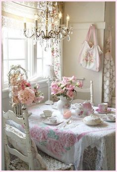 Romantic pink and white themed shabby chic breakfast nook by windows. Fresh pink flowers for table decoration! All in love!