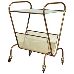Bar Cart and Magazine Rack in the Style of Mathieu Matégot | From a unique collection of antique and modern bar carts at https://www.1stdibs.com/furniture/tables/bar-carts/