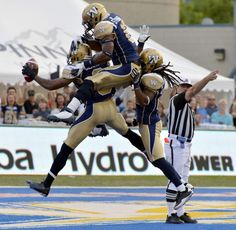 Winnipeg Blue Bombers' Johnny Sears (L) celebrates his interception against the BC Lions with Brandon Stewart (C) and Jonathan Hefney during the first half of their CFL game in Winnipeg, August (Fred Greenslade/Reuters) Sports Images, Sports Pictures, Winnipeg Blue Bombers, Flag Football, Win Or Lose, Michael Phelps, Home Team, High Five, Summer Olympics