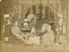 Family portrait of an English colonial official with his Indian servants - Northeast India c.1880