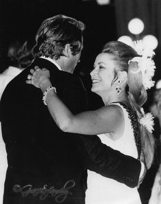Princess Grace dancing with Gregory Peck during the annual Red Cross Ball.