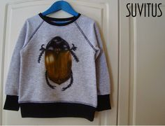 DIY beetle shirt for my son. I tried to draw a bug with Pentel farbricfun crayons. Crayons, Beetle, Sons, Draw, Sweatshirts, Sweaters, Fashion, June Bug, Beetles