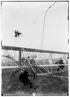 Orville Wright seated in Wright airplane with Albert B. Lambert before takeoff; Simms Station, Dayton, Ohio.