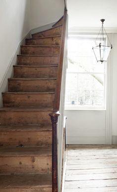 worn wood stairs and white
