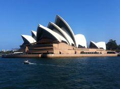 Tiny motor boat in front of the Sydney Opera House, Australia.   www.boat-spotting.com