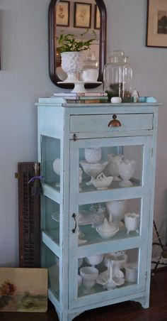 Milk Glass Collection in a Light Blue Cabinet, The blue really compliments the vintage milk glass. It is an excellent color for milk glass displays. ~MWP - Chateau Chic: A Charming Home Tour