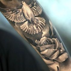 An amazing tattoo of a dove and rose inked in dotwork style. Style: Dotwork. Color: Gray. Tags: Amazing, Beautiful