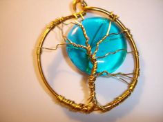 blood moon/blue moon and tree of life - JEWELRY AND TRINKETS - I am just learning about wire wrapping and beads. This is my first two tries with the tree of life and a moon. Wire Wrapped Jewelry, Metal Jewelry, Beaded Jewelry, Tree Of Life Jewelry, Tree Of Life Pendant, Wire Crafts, Jewelry Crafts, Wire Trees, Blood Moon
